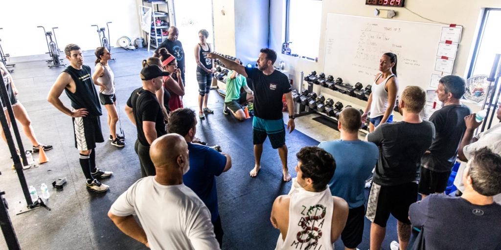 EOB CrossFit coach teaching their restore class